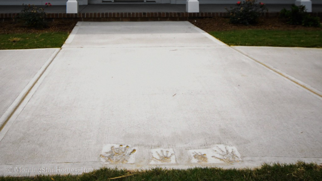 Client handprints in their new driveway.