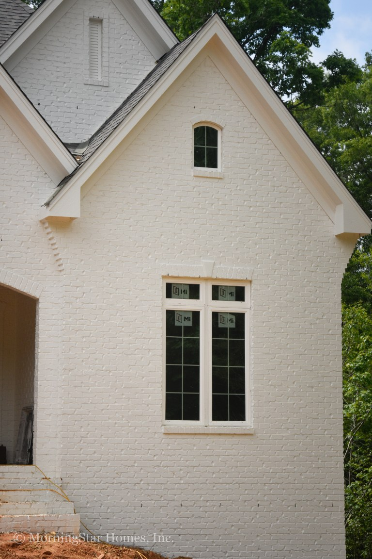 Beautiful textured brick, painted a classic white