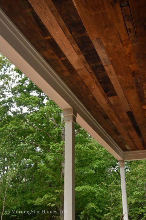 Custom reclaimed barn wood ceiling on the porch