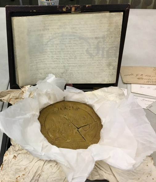The wax seal was imprinted with an image of Queen Victoria. Unfortunately, the wax cracked prior to its donation to the MSU Archives.