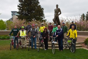 The group posing in front of Sparty, spring 2015 Tour de MSU