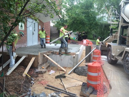 Pouring and leveling out the concrete.