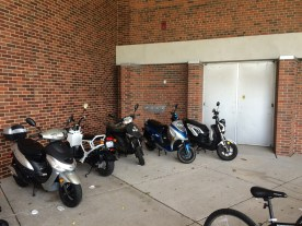 SW entry bike parking area to Wells Hall blocking fire exit to one of the large auditoriums.