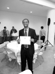Physics sophomore Iwentim Abate receives a People's Choice Award at the 2nd Annual National Collegiate Research Conference on Jan. 26.