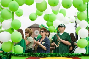 People clapped to a Celtic song that played as their float drove on Broadway.