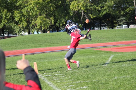 Wide receiver Adam Jiskra hauls in a pass in the Dragon's Homecoming game.