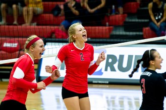 VanWinkle and teammate Annie Palmquist celebrate after earning a point for the Dragons. The Dragons bring a 10-5 record into this weekend's matches.