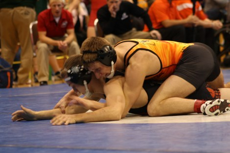 True freshman, Blake Bosch wrestles for the Dragons on Saturday. Bosch lost the match by decision 7-2, against SDSU's Isaac Andrade. Bosch went 1-2 in the tournament. This was the first tournament for the Dragons as a team.