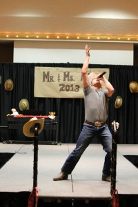 Mr. MSUM, Pat Richard, sings with country passion on the CMU Ballroom stage. His arms thrown up to the sky during the talent portion of the pageant in hopes of being crowned the new Mr. MSUM.