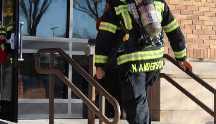 02-firefighter-anderson-entering-maclean-hall