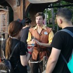 MSU sophomore Connor Tilford welcomes guests outside Disney's Seven Dwarfs Mine Train.