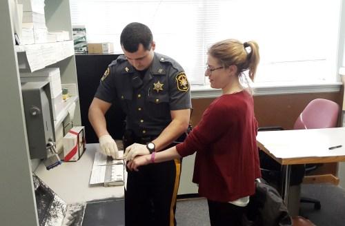 Rebecca Gets Fingerprinted