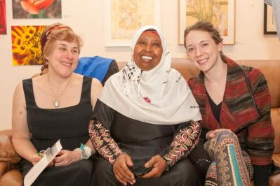 """Opening of the """"Flowers, Flores, Ubaxa"""" exhibition at the Mount Baker Neighborhood Center for the Arts. Gallery owner Barbara Oswald with Featured Artist Hawo Ali and ArtXchange Gallery manager Lauren Davis."""