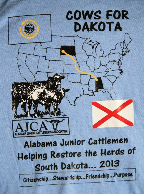 T-shirts made by the Lauderdale County Junior Cattlemen's Association of Alabama to commemorate their trip to South Dakota to help families in the Union Center area in the summer of 2014. More than 30 young people stayed with area ranching families, providing free labor in addition to 21 donated yearling heifers.