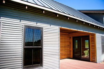 Corrugated metal roofing and siding panels