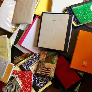 photo of a pile of binders and papers