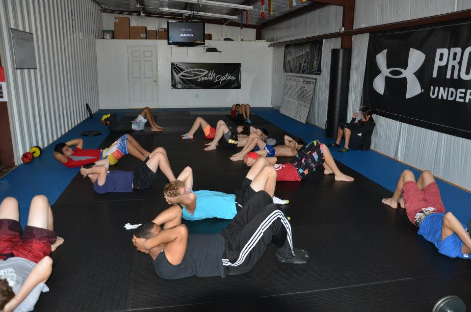 Riders exercise at the gym as a part of training