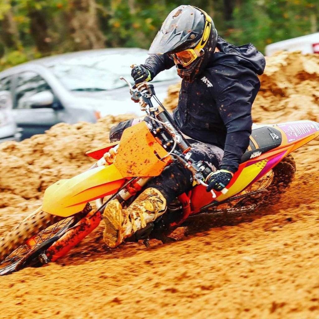 Dominic Grenga races through a corner on the motocross track