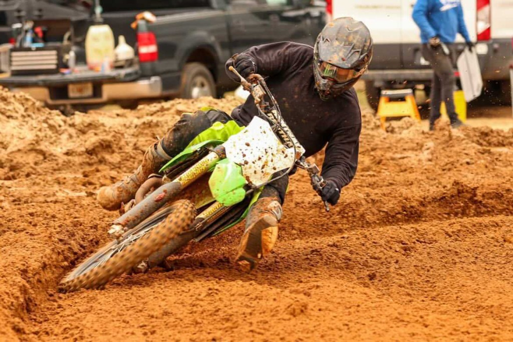 Alec Sikes flies through a corner on the motocross track.