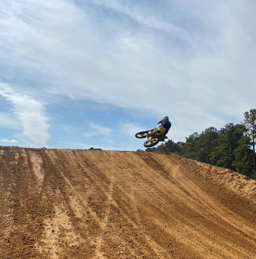 Sebastian Pakciarzwhips over a jump on the motocross track.