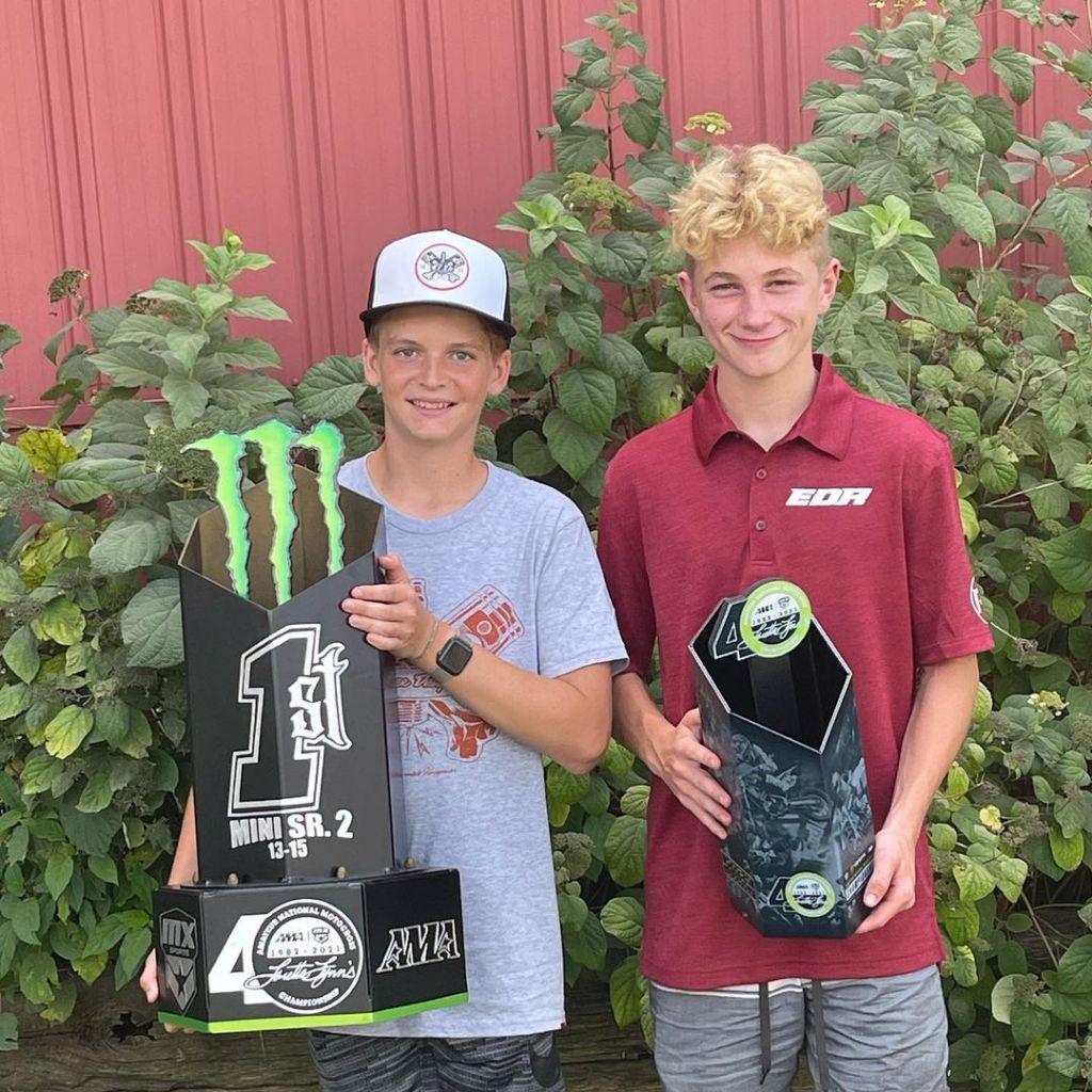Thomas (Tiger) Wood and Will Campbell with their trophies from the Loretta Lynn Amateur National Championship.