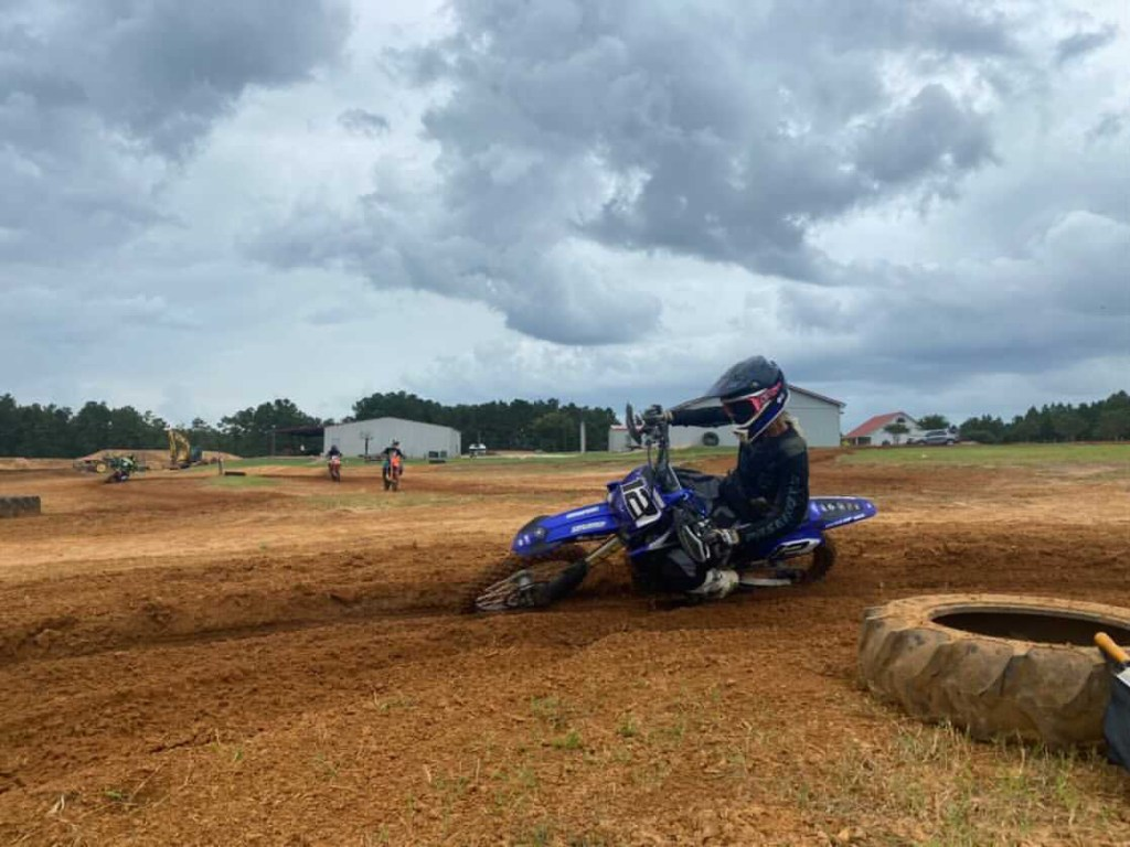 Matthew Cemovic speeds through a corner on the motocross track.