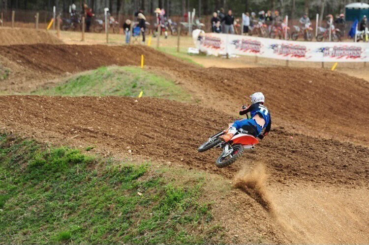 Blake Smith whips over a tabletop at a motocross race.