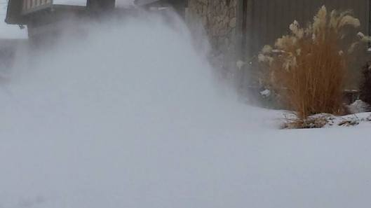 Husband running snowblower in frigid cold and wind
