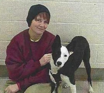 Katie Garding and a dog she trained through the Prison Paws program