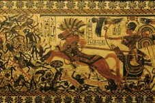 Pharoah Tutankhamen on a chariot, pursuing Nubians