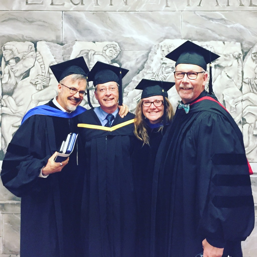 four professors standing together at convocation