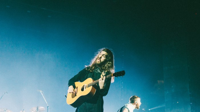 "Wayne Sermon of Imagine Dragons performs at Bridgestone Arena in Nashville, Tenn. on Wednesday, June 8, 2015, The performance was part of the band's ""Smoke + Mirrors"" tour. (MTSU Sidelines / Andre Rowlett)"