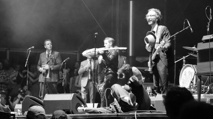 St. Paul and the Broken Bones frontman Paul Janeway, center, lies down on stage as bassist Jesse Phillips, right, looks on at the Sloss Music & Arts Festival in Birmingham, Ala., on Sunday, July 19, 2015. (MTSU Sidelines / John Connor Coulston)