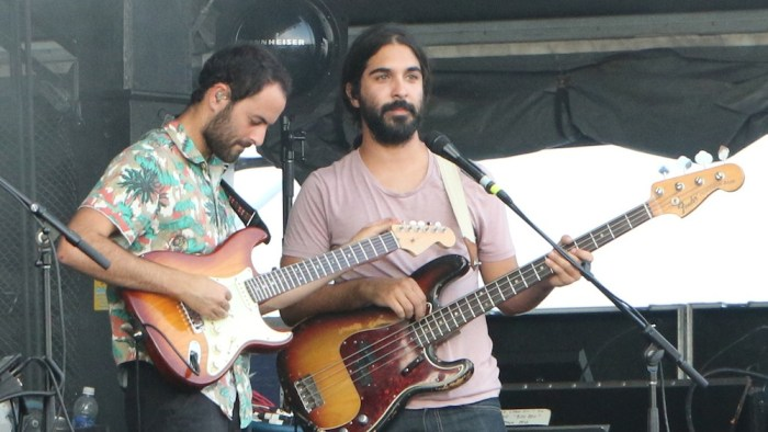Eric Cannata, left, and Payam Doostzadeh, right, of Young the Giant perform at the Sloss Music & Arts Festival in Birmingham, Ala., on Saturday, July 18, 2015. (MTSU Sidelines / John Connor Coulston)
