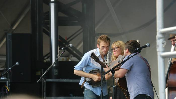 Chris Thile, left, Sara Watkins, center, and Sean Watkins, right, of Nickel Creek perform at the Forecastle Festival in Louisville, Kentucky on Sunday, July 20, 2015. (MTSU Sidelines / Dylan Skye Aycock)