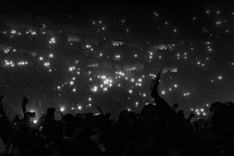 """Camera lights flashes as Trey Songz takes the stage at Bridgestone Arena in Nashville, Tenn. on Sunday, March 1, 2015. The concert was a part of he and Chris Brown's """"Between the Sheets"""" tour. (Andre Rowlett / MTSU Sidelines)"""