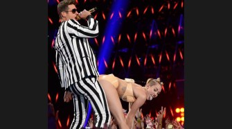 """Robin Thicke, left, gets twerked on by Miley Cyrus, right, during a performance of """"Blurred Lines"""" the 2013 Video Music Awards in Brooklyn, New York on Sunday, August 25, 2013. (FILE)"""