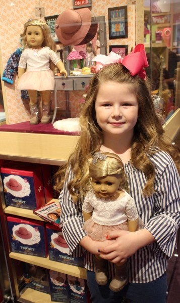 Sailor Hunter poses with her new Tenney doll. (Sidelines / Tayhlor Stephenson)
