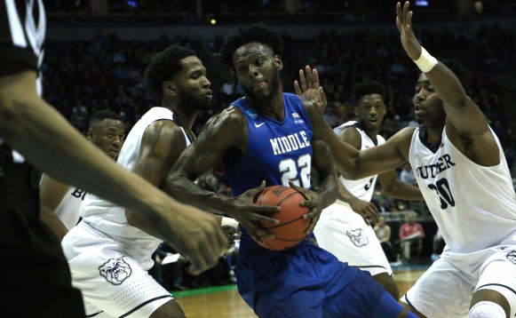 JaCorey Williams (22) backs down a defender during an NCAA Tournament second-round game against Butler in Milwaukee, WI on March 19, 2017. (MTSU Sidelines/Tyler Lamb)