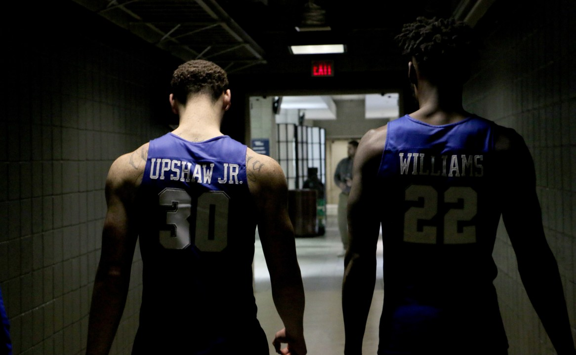 Reggie Upshaw (30) and JaCorey Williams (22) walk the hall to their locker room following an NCAA Tournament second-round game against Butler in Milwaukee, WI on March 19, 2017. (MTSU Sidelines/Tyler Lamb)