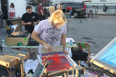 Ethan Rose creates screen prints live at Boro Fondo Bazaaro Saturday. (Sidelines / Wesley McIntyre)