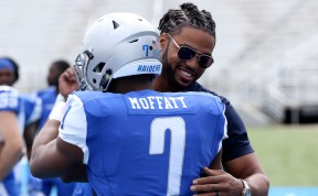 Javonte Moffatt greets former lineman Steven Rhodes during the Blue-White Spring Finale at Floyd Stadium on April 15, 2017. (MTSU Sidelines/Tyler Lamb)