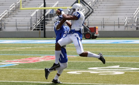 CJ Windham snags a catch through the arms of Darryl Randolph during the Blue-White Spring Finale at Floyd Stadium on April 15, 2017. (MTSU Sidelines/Tyler Lamb)