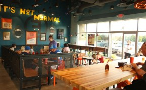 Customers eat in a stylish and uniquely decorated dining room at Freebirds World Burrito in Murfreesboro, Tenn. on July 18, 2017. (Connor Burnard / MTSU Sidelines)