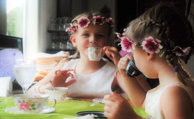 Riley Thomas of Murfreesboro (left) and Avery McDowell of Lebanon sip tea at the Southern Charm Woodland Fairy Tea Party in Bell Buckle, Tenn. on July 8, 2017. (Meredith White / MTSU Sidelines)