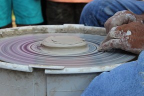 Sculptor Roy Overcast starts a pottery piece to show children how his work is made at Oaklands Mansion's Autumn in the Oaks Educational Field Day in Murfreesboro, Tenn. on September 21, 2017. (Shade Narramore / MTSU Sidelines)