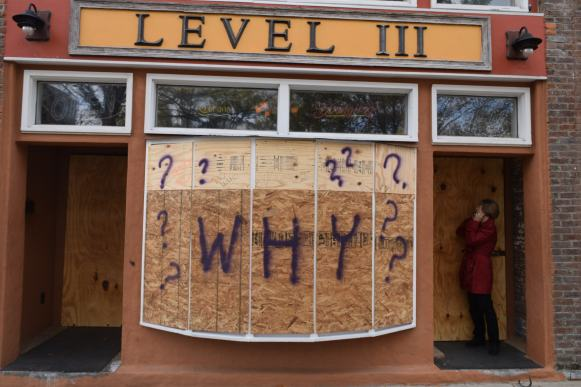"""Why"" is written in spray paint on the boarded-up storefront of the bar, Level III, in Murfreesboro, Tenn. on Oct. 28, 2017. (Andrew Wigdor / MTSU Sidelines)"