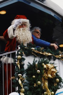 Ricky Skaggs and Santa continue to toss gifts to families in Dungannon, Virginia, on Nov. 18, 2017. (Anthony Merriweather / MTSU Sidelines)