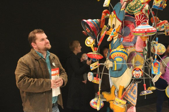 Eric Ernst admires some of Nick Cave's sculptures at the Frist Family Festival Day in Nashville, Tenn. on Sunday, Nov. 12, 2017. (Shade Narramore / MTSU Sidelines)