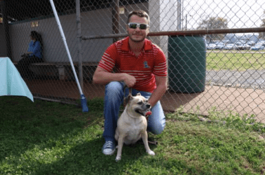 Dottie Too Hottie, a 6-year-old pug and chihuahua mix, stops for a photo with owner Cade Seaman for Bark in the Park in Tullahoma, Tenn. on Nov. 4, 2017. (Victoria Leuang / MTSU Sidelines)